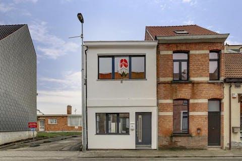 gerenoveerde half open bebouwing met twee slaapkamers in centrum temse