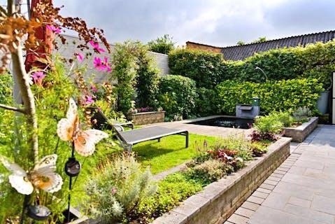 Halfopen huis met 3 slaapkamers en tuin te koop in Roeselare
