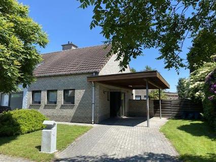 Half open bebouwing met 3 slaapkamers, carport en tuin nabij het centrum van Rupelmonde.