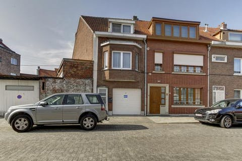 Merksem - Huis met grote garage/magazijn (+/-140m²)