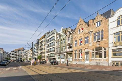 Modern gelijkvloers appartement met authentieke elementen