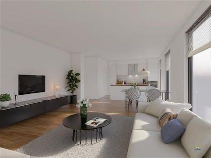 Nieuwbouw gelijkvloers appartement met drie slaapkamers, tuin en carport in het centrum van Bornem