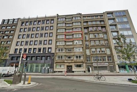 Riant appartement met 4 slaapkamers te koop in centrum Antwerpen.