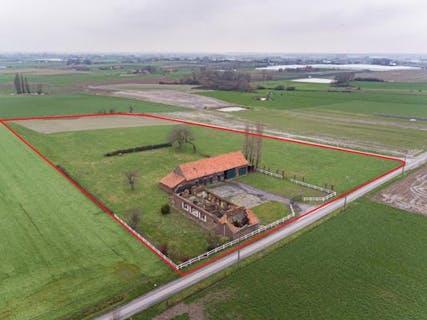 Te herbouwen hoeve op 1,6 ha met wondermooi verzicht